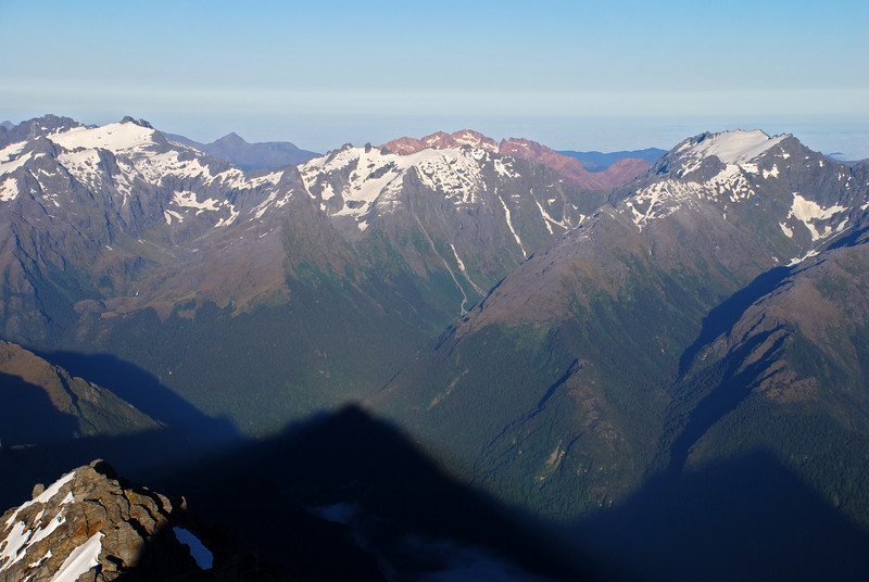 Looking west from Mt Ionia. Red Mountain stands out behind the Retreat Pinnacles, the Remote Peaks are to the right, Typhoon Peak and Toreador Peak on the far left.