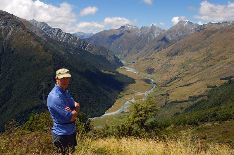 Aaron at bushline en route to Cascade Saddle, West Matukituki Valley. Fog Peak, Sharks Tooth Peak and Craigroyston Peak behind.