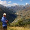 Aaron at bushline en route to Cascade Saddle, West Matukituki Valley. Fog Peak, Sharks Tooth Peak and Craigroyston Peak behind.