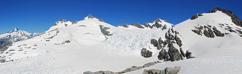The upper Snow White Glacier from our campsite north of Pivot Peak. From left to right are Mt Aspiring, Maiti-iti, Mt Maruiwi, Mt Maoriri, Whitbourne Saddle, Pivot Peak.