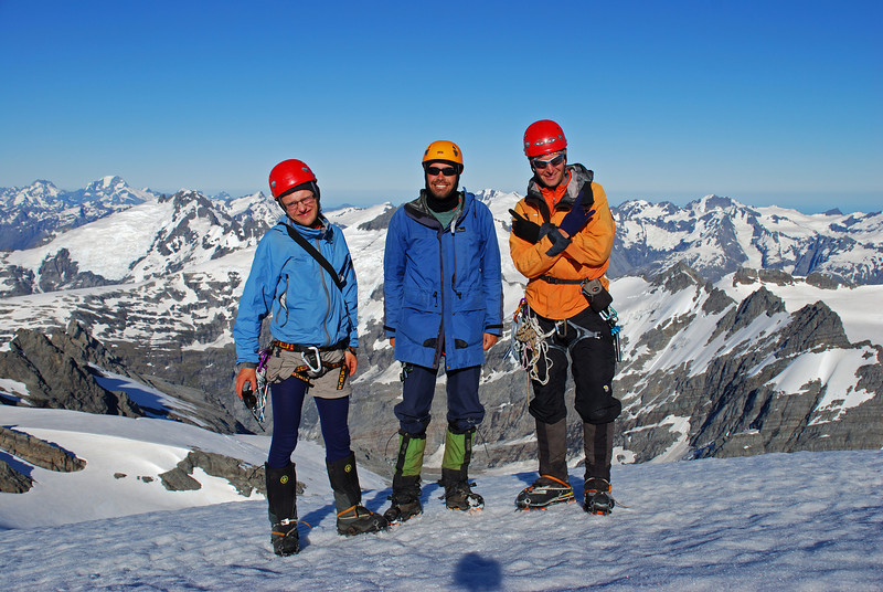 Big grins - not a breath of wind, not a  single cloud in the sky. Mt Edward summit.