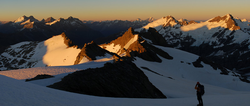 Up high on the south-west ridge of Mt Edward. Sunrise over the Forbes Mountains (left), Darran Mountains (centre-right) and Snowdrift Range (front).