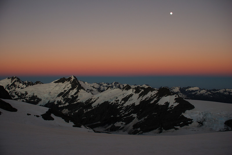 First daylight on the Snowdrift Range, from up high on Mt Edward. Mt Ian and Mt Lydia to the left, the Snowball Glacier to the right.