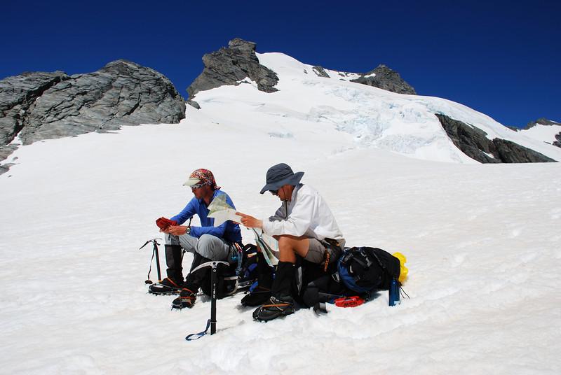 Map reading on Whitbourn Saddle. Mt Maoriri above.
