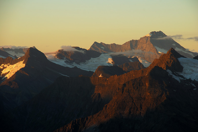 View from the summit of Leda Peak. Pickelhaube, Popes Nose, Mt Aspiring, Mt Betsy Jane at sunrise