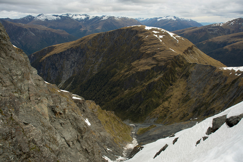View down Wilson Creek from the saddle west of Burnt Top. Mount Cross is at centre image. Camerons Creek is right behind Mt Cross, with the Young Range on the left, Mt Shrimpton and the McKerrow Range on the right.