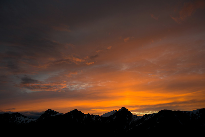Sunset from our bivvy site just north of Mt Cross. Mount Cameron is the prominent peak just right of centre image