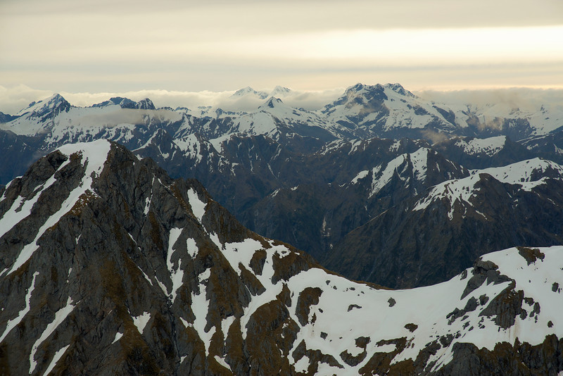 Panorama from Lindsay Peak. Mount Burke is in the foreground on the left. Peaks on the skyline are Mt Aeolus, Mt Kuri, Pollux, Castor and Mt Alba. Mt Awful is exactly in front of Mt Alba, while unnamed peak pt 2026m is in front of Castor.