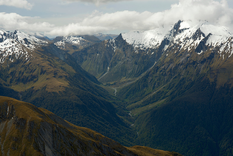 View into Strachan Creek from Burnt Top. Mount Abrupt and Mt Peaceful are at the left edge of the image, The Joker is in cloud on the far right. MacPherson Knob stands out above Mac Saddle at centre image.