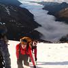 Laura, Jimmy and Cleo climbing Mt Heim