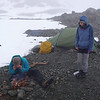Cleo, Tiff and Laura appreciate an excellent fire 600m above bushline in the snow and drizzle
