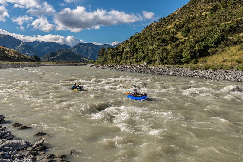 Running the rapid towards the Wharekiri Bluff (at the toe of Corner Hill)