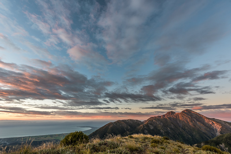 At sunrise on Mount Stace. Gable and Gables End get the first rays of sun, while the Kaikoura Peninsula is still in the shade.