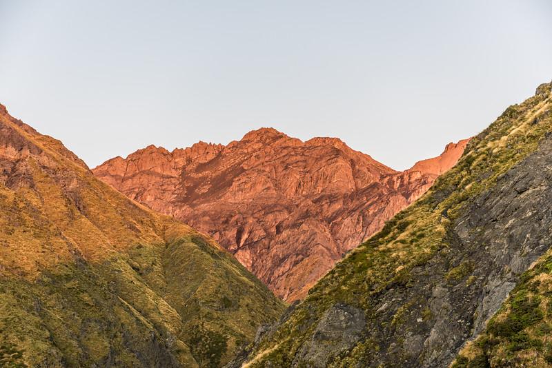 Sunrise on the lower ramparts of Manakau from Surveyor Spur