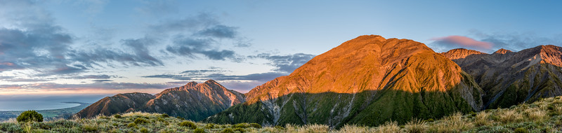 Panorama from Mount Stace at sunrise. From left to right are the Kaikoura Peninsula, Gable, Gables End, Uwerau and Manakau.
