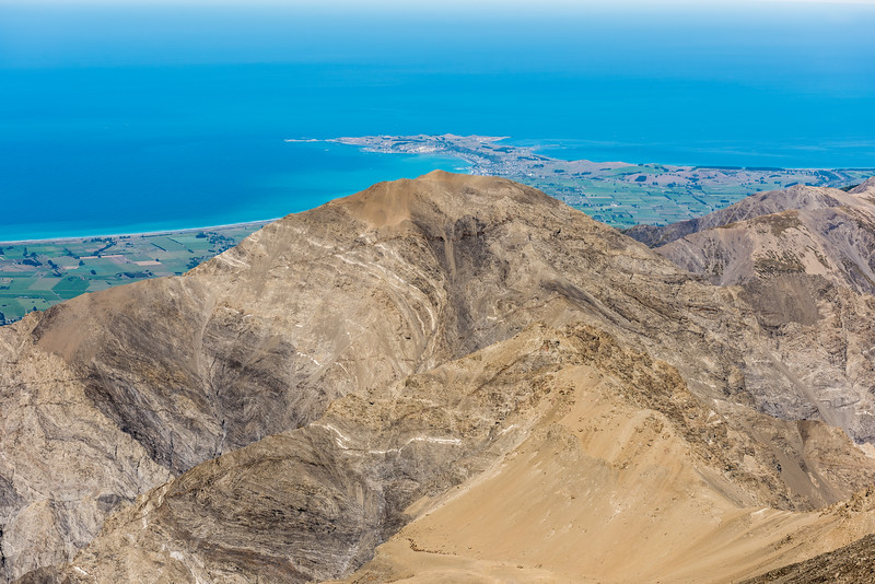 The Kaikoura Peninsula juts out into the Pacific Ocean behind the summit of Uwerau