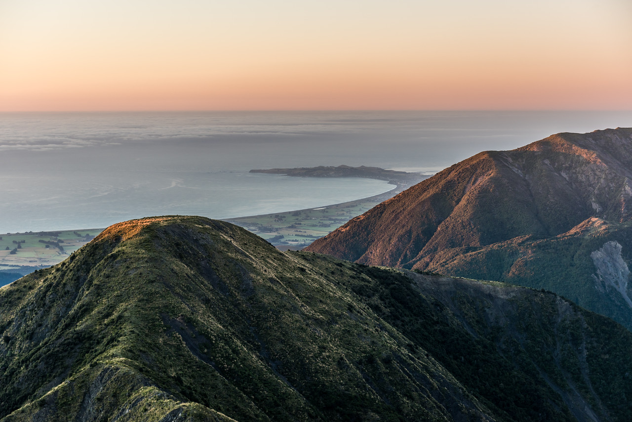 Looking over Mount Stace to the Pacific Ocean and the Kaikoura Peninsula. Surveyor Spur, Manakau.