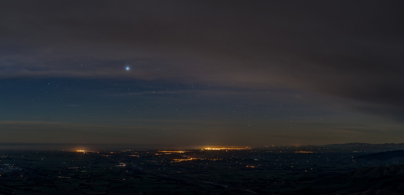 Night view of the Canterbury Plains from the top of Little Mount Peel / Huatekerekere. The city lights of Timaru at centre image