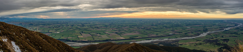 View across the Canterbury Plains from Little Mount Peel / Huatekerekere. The Rangitata River is in the foreground