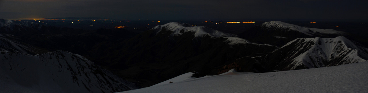 Night view from peak 2093m, Mt Somers Range. The lights of Ashburton are visible between Mt Winterslow and Mt Somers. Left of Mt Winterslow is Methven, and Christchurch on the far left