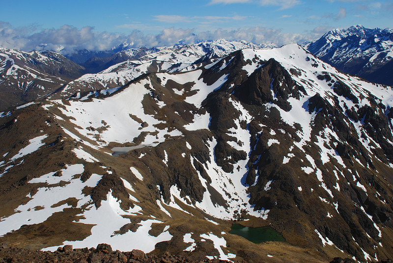 Looking north over the Livingstone Mountains from unnamed peak 1777m. Our descent route on the right below the tarns