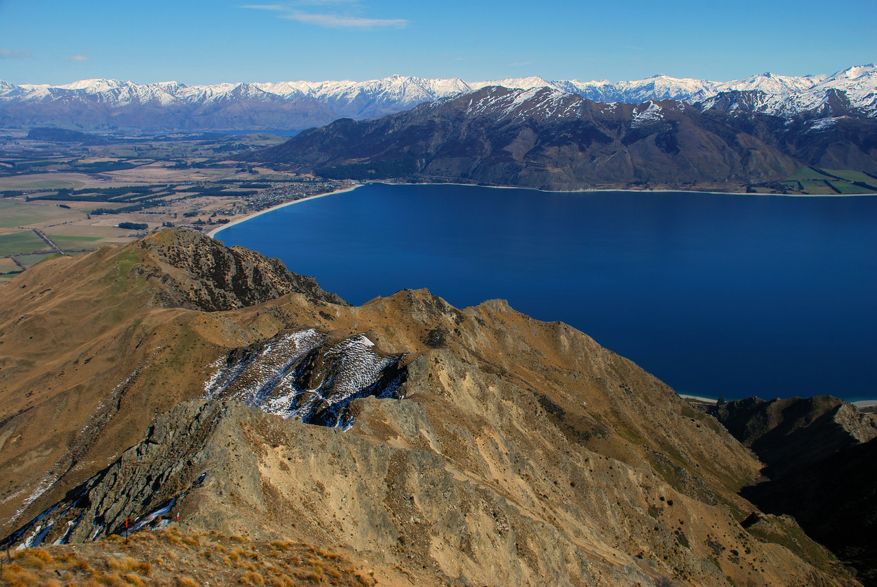 View of Lake Hawea from Breast Hill Track. The track follows the eroded ridge in the foreground