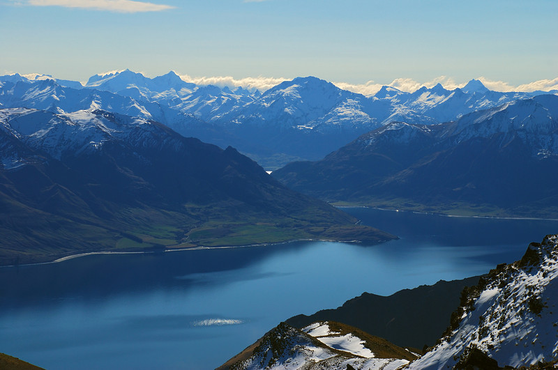 View of Lake Hawea and the Southern Alps from near the summit of Breast Hill. On the sky-line from left to right are Mount Pollux, Mount Castor, Albert Peak, Mount Alba