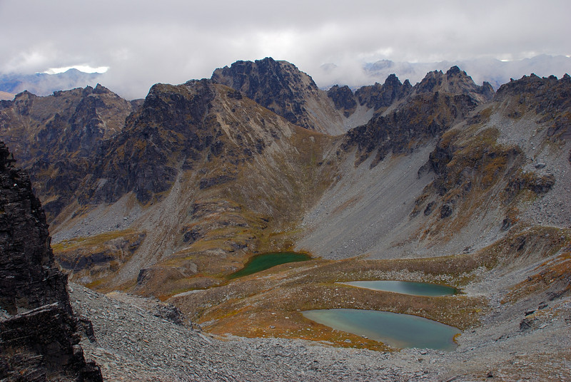 The Three Lagoons from the west ridge of Cecil Peak. Unnamed peak 1827m behind