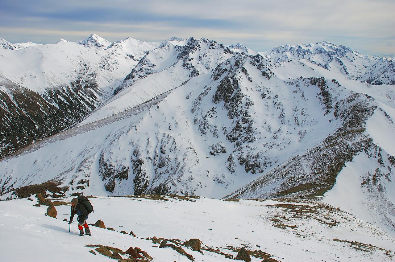 Robert nearing the summit of pt 1552m. Helen Peaks (left) and Jane Peak (right) behind