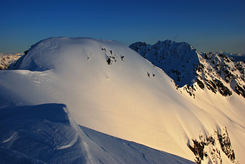 On Jane Peak's northern outlier 1876m at sunrise. Peak 1902m to the right of centre image.