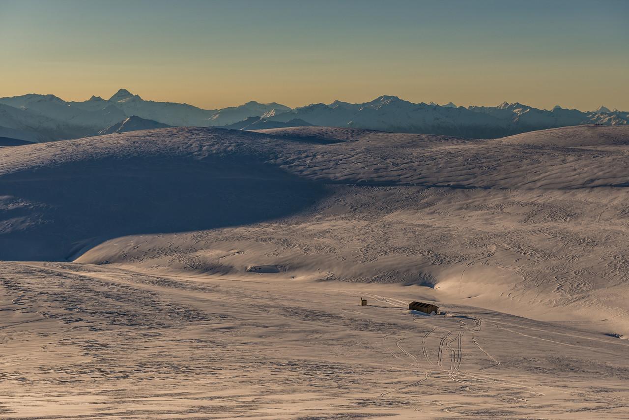 Kirtle Burn Hut, Pisa Range. Mount Aspiring / Titittea in the background