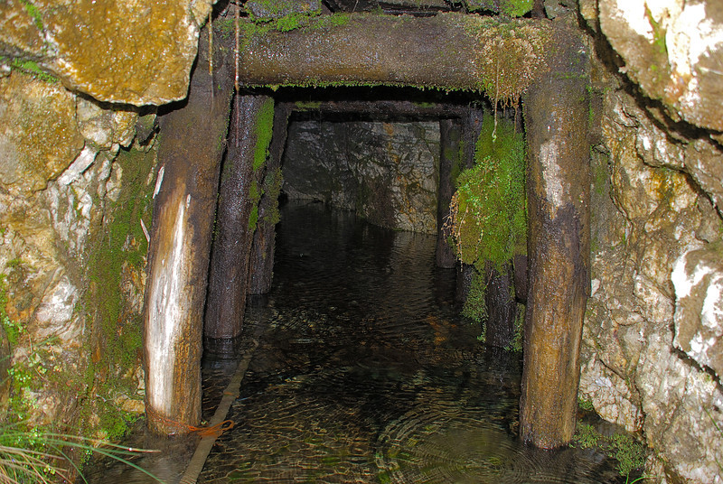 A partially submerged mining tunnel near Bonnie Jean Hut