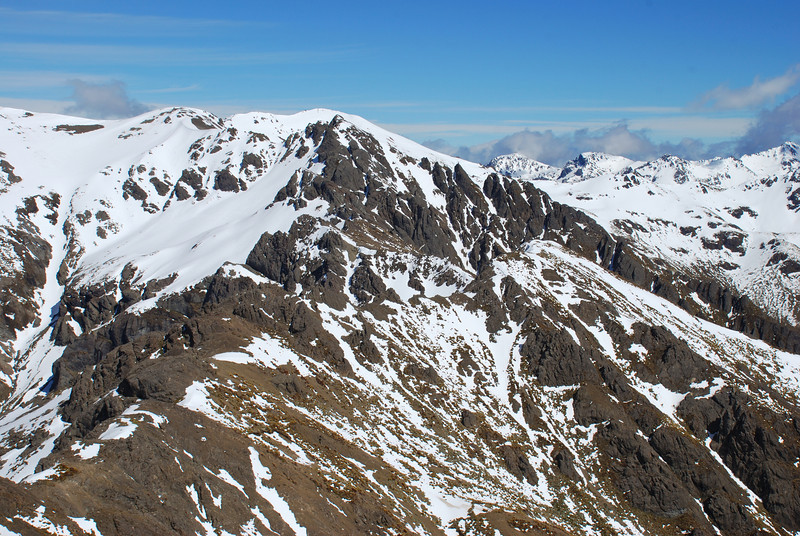 The ridge leading to the Wairaki Peaks from the McLean Peaks. Spence Peak behind