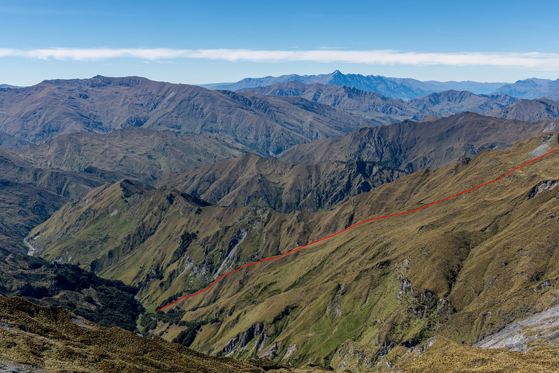 The best route from Skippers Creek Right Branch into the Left Branch follows a tussock spur to Pt 1475m, not the eroding creek bed below. A marker pole at the bottom of the spur indicates where the route leaves the valley floor