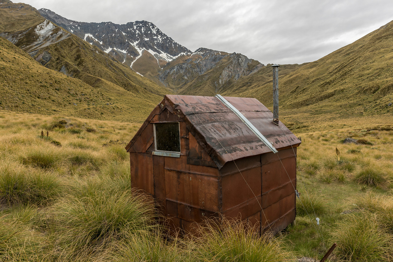 Archie's Hut by Copper Creek in Aurum Basin. Mount Aurum above