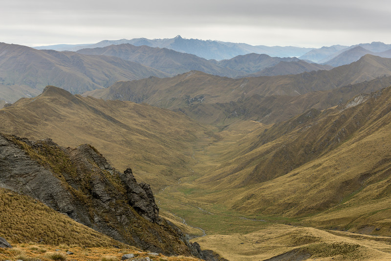View into Aurum Basin and Aurum Creek from the southern slopes of Mount Aurum. The Remarkables are on the skyline at centre image