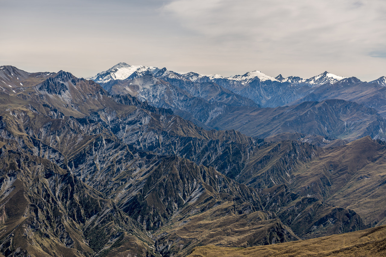 View from Prince of Wales. From left to right are Mt Aspiring / Tititea, Rob Roy Peak (in front of Aspiring), Mt Repulse, Unnamed Pt 2108m, Craigroyston Peak (snow covered), Sharks Tooth Peak, Fog Peak. In the back between Pt 2108m and Craigroyston are Fastness Peak and Pickelhaube