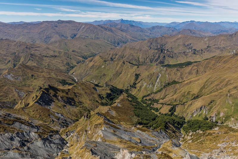 View into Skippers Creek Right Branch from Prince of Wales. The Remarkables and Double Cone are on the skyline at centre image