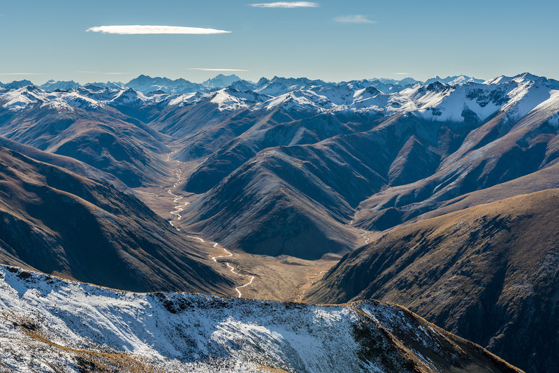 View into the Oreti River headwaters from the summit of Mt Campbell. Mount Earnslaw in the back