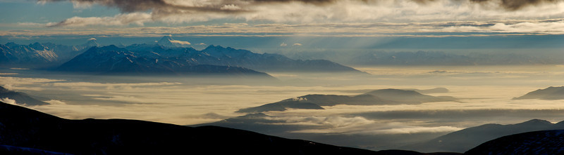 Aoraki/Mt Cook and the MacKenzie Country at sunrise. View from the summit of Mt St Bathans