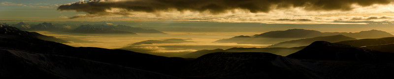 Sunrise over the MacKenzie Basin and Mt Cook, from the summit of Mt St Bathans