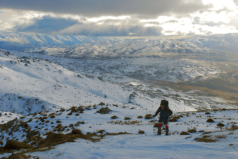 Snow-shoeing up the Omeo Gully Track, Old Man Range. The Old Woman Range on the left