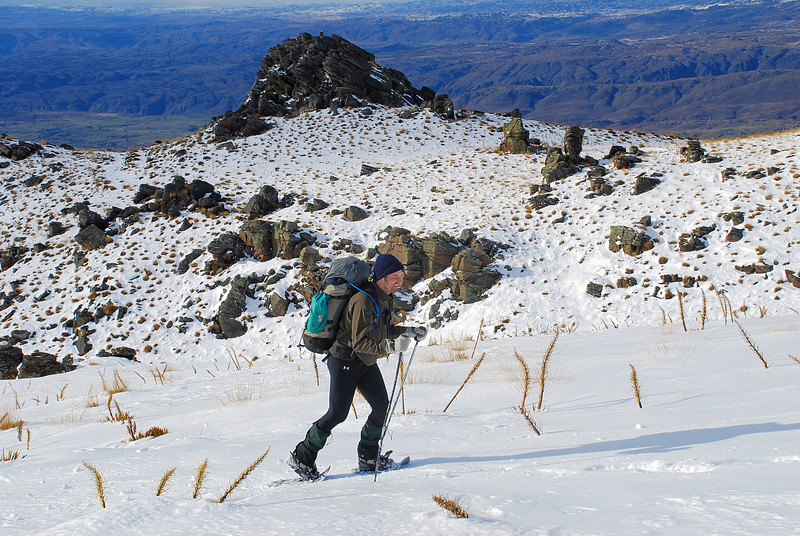 Nick, still smiling while snow-shoeing up the Omeo Gully Track, Old Man Range. Prophets Rock in the background