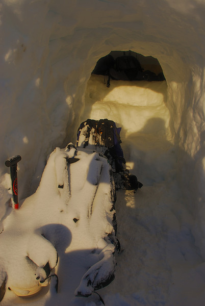 Morning light on the stairs leading to the sleeping platforms - and on our snow-covered packs