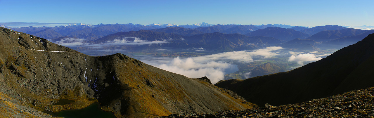 View of the Southern Alps across the Wakatipu Basin from the NE ridge of Telecom Tower, The Remarkables