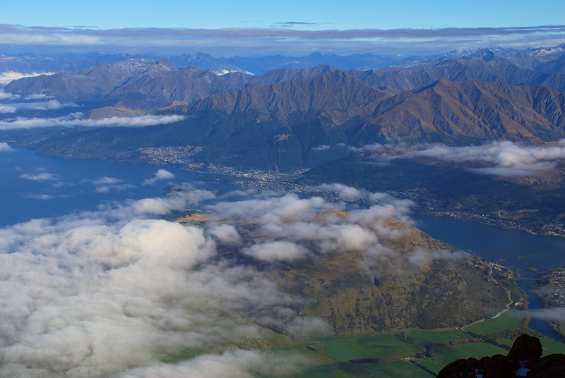 View of Queenstown and the Frankton Arm of Lake Wakatipu from the gap in the ridge south of Telecom Tower, The Remarkables. Kelvin Peninsula in the foreground. Mt Crichton, Ben Lomond and Bowen Peak are the three prominent mountains above Queenstown