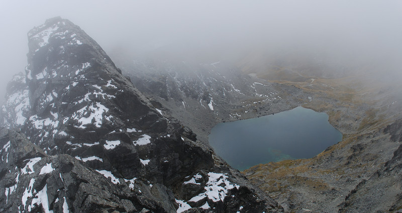 Looking back to the first summit of Double Cone and Lake Alta