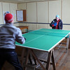 Playing table tennis to keep warm
