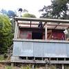 Steven cuts wood at the hut