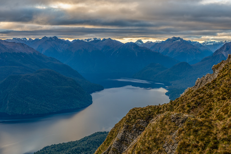 Head of Lake Te Anau from the south ridge of End Peak. Mount Mitchelson and Mount Anau are on the skyline.